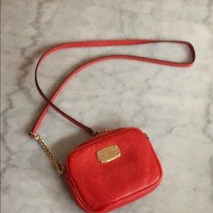 Michael Kors leather crossbody purse in orange